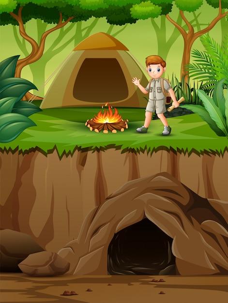 Junger pfadfinder in der campingzonenszene Premium Vektoren