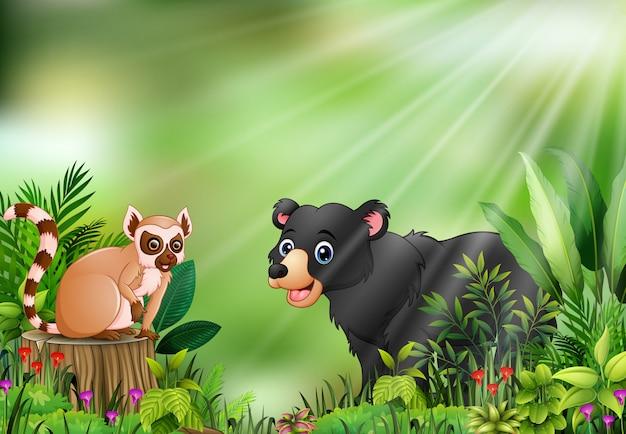 Karikatur der naturszene mit einem maki, der auf baumstumpf und schwarzem bären sitzt Premium Vektoren