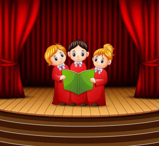 Karikatur des kinderchors, der am stadium durchführt Premium Vektoren