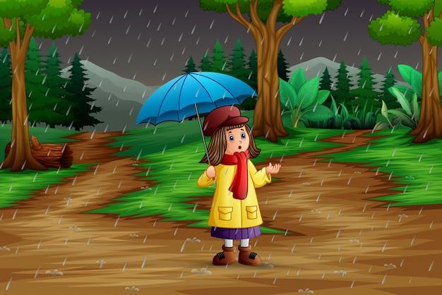 Karikatur ein tragender regenschirm des mädchens unter dem regen Premium Vektoren