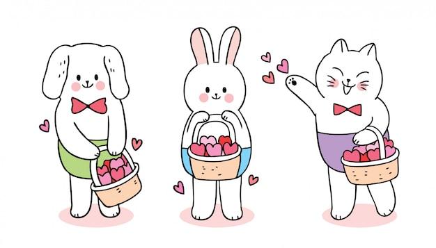 Karikatur nette valentinstagkatze und hund und kaninchen und herzen im korbvektor. Premium Vektoren