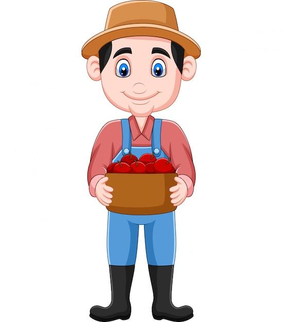 Karikaturlandwirt, der einen korb der äpfel hält Premium Vektoren