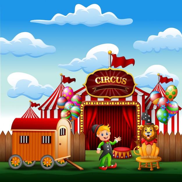 Karikaturtrainer mit einem löwen auf dem zirkus-eingang Premium Vektoren
