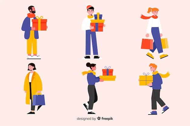 Kaufende weihnachtsgeschenke der flachen designleute Kostenlosen Vektoren