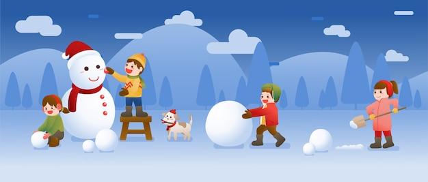 kinder bauen einen schneemann und spielen schnee