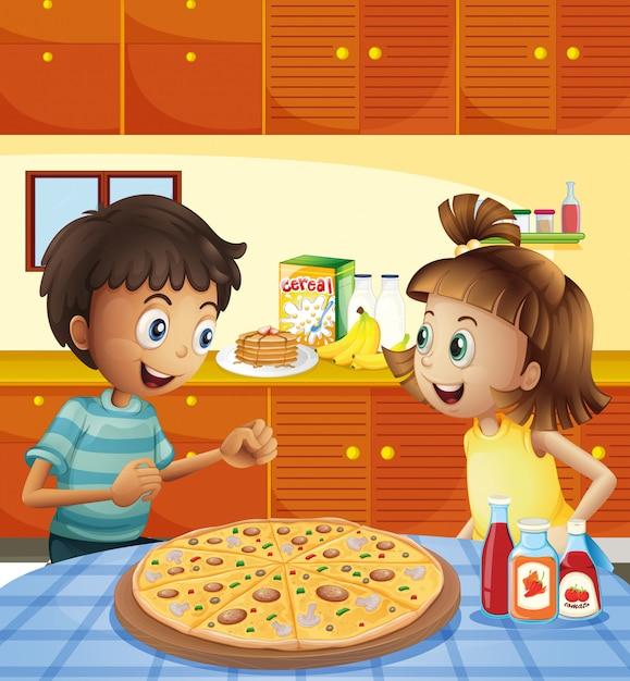 Kinder in der küche mit einer ganzen pizza am tisch Premium Vektoren