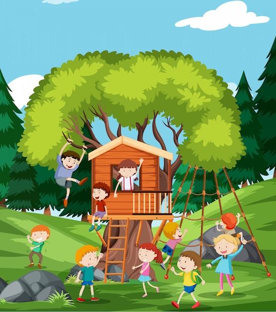 Kinder spielen am baumhaus Premium Vektoren