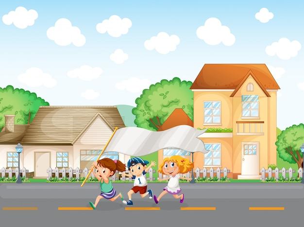 Kinder vor den großen häusern mit einem leeren banner Kostenlosen Vektoren