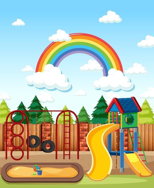 kinderspielplatz im park mit regenbogen im himmel am tag