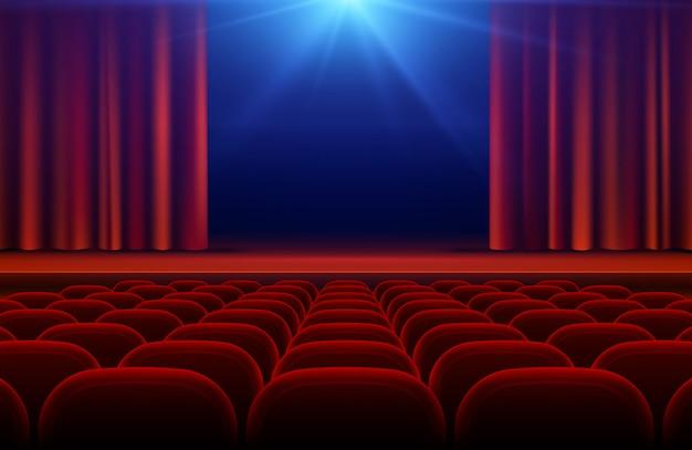 Kino- oder theaterhalle mit stadium, rotem vorhang und sitzen vector illustration Premium Vektoren