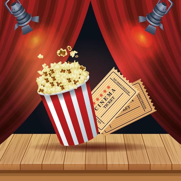 Kinounterhaltung mit popcorn- und kartenillustration Premium Vektoren