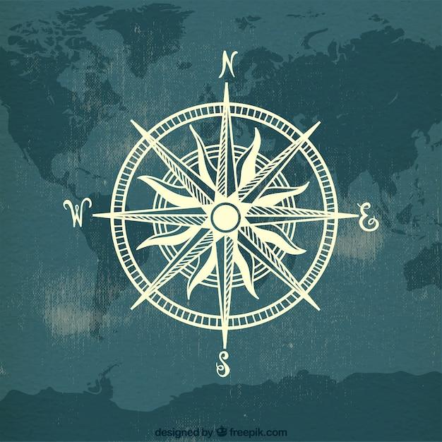 Kompass auf karte welt hintergrund Kostenlosen Vektoren