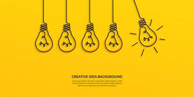 Kreative idee mit glühlampefahne Premium Vektoren
