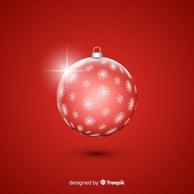 Kristallweihnachtsball auf rotem hintergrund Kostenlosen Vektoren