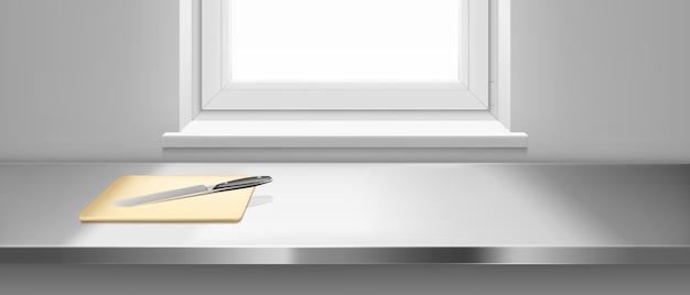 Küchenstahltisch mit schneidebrett und messer Kostenlosen Vektoren