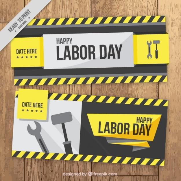 Labor day banner mit schraubenschlüssel und hammer Kostenlosen Vektoren