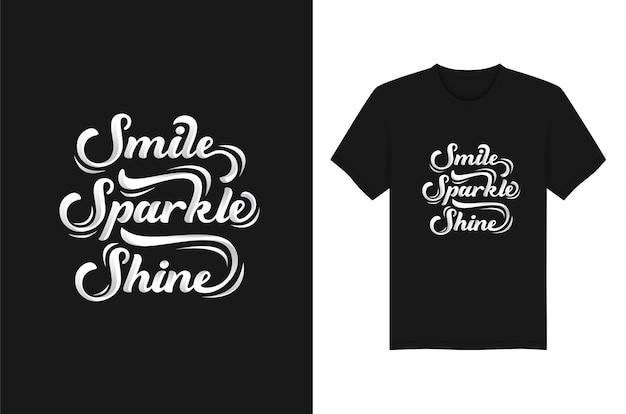 Lächeln. funkeln. glanz-beschriftungs-typografie für t-shirt design Premium Vektoren