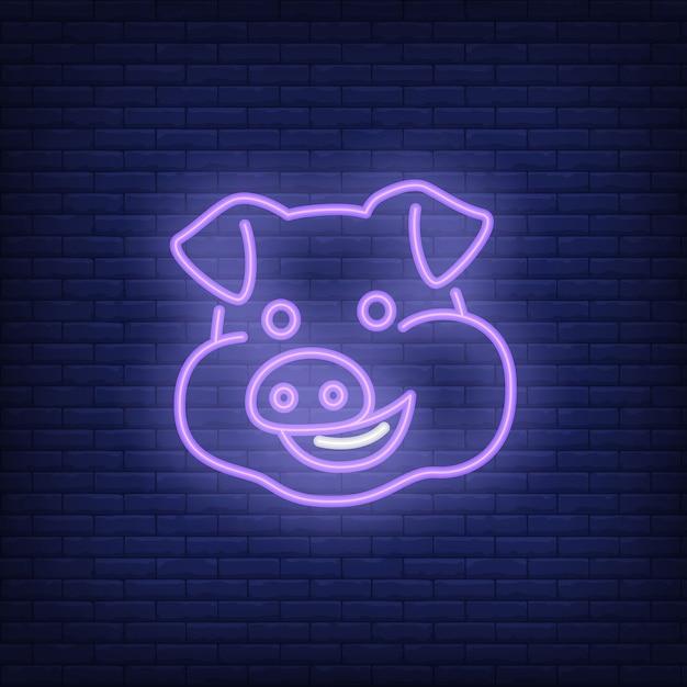 Lächelnde schweinzeichentrickfilm-figur. leuchtreklame element. nacht helle werbung. Kostenlosen Vektoren