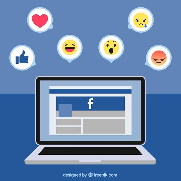 Laptop hintergrund mit facebook und symbole Kostenlosen Vektoren