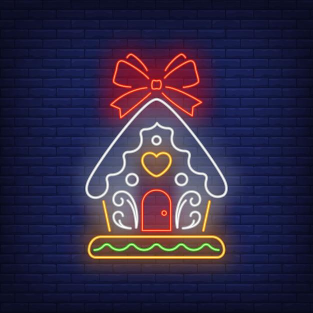 Lebkuchenhaus mit roter schleife in der neonart Kostenlosen Vektoren