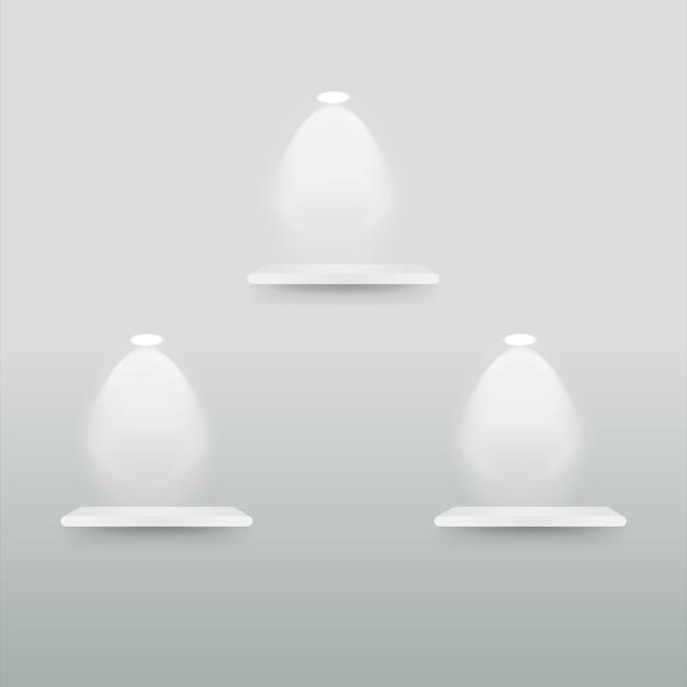 Leeres anzeigenregal mit scheinwerfern Premium Vektoren