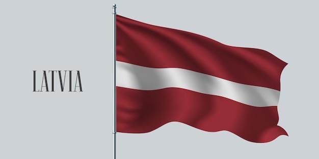Lettland wehende flagge auf fahnenmast Premium Vektoren