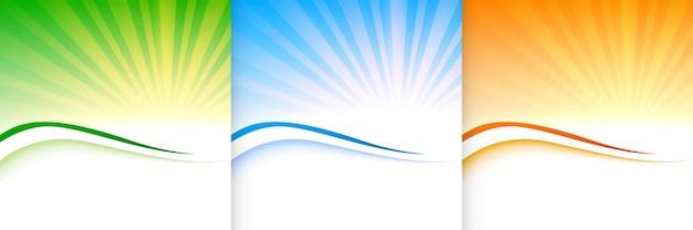 Leuchtender sunburst in drei farben Kostenlosen Vektoren