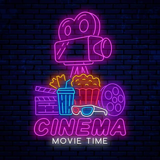 Leuchtreklame für das kino lokalisiert auf realistischer wand Premium Vektoren