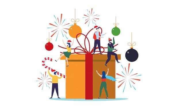 Leute, die für weihnachten auf einer großen geschenkbox verzieren Premium Vektoren