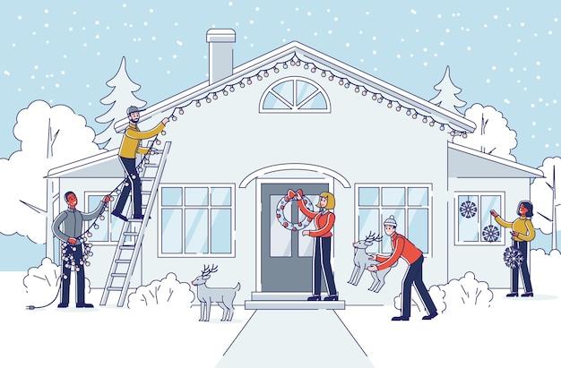 Leute, die haus und garten für weihnachten und neujahrsferien draußen verzieren. Premium Vektoren