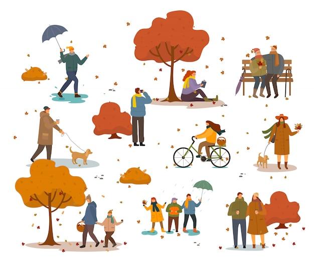 Leute, die in autumn golden park gehen oder sitzen Premium Vektoren