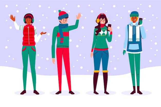 Leute, welche die winterkleidung eingestellt tragen Kostenlosen Vektoren