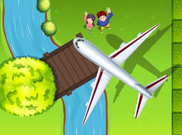 Luftaufnahme des flugzeuges fliegend über den park Kostenlosen Vektoren
