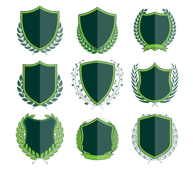 Luxuriöse grüne abzeichen laurel kranz-sammlung Premium Vektoren