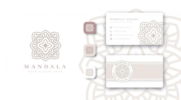 Luxuriöses goldenes mandala-logo mit visitenkarte Premium Vektoren