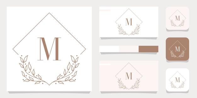 Luxusbuchstabe m logoentwurf mit blumenrahmenschablone, visitenkartenentwurf Premium Vektoren