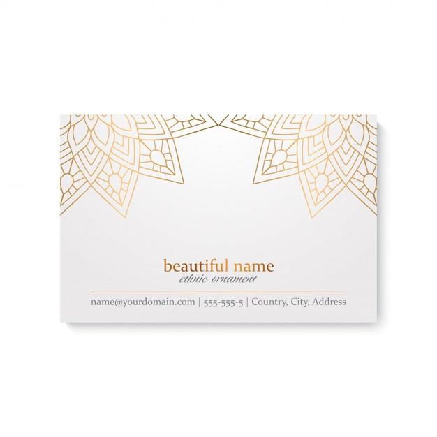 Luxusvisitenkarteschablone mit ethnischer art-, weißer und goldenerfarbe Kostenlosen Vektoren