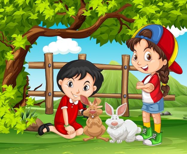 Mädchen, die mit kaninchen im bauernhof spielen Kostenlosen Vektoren
