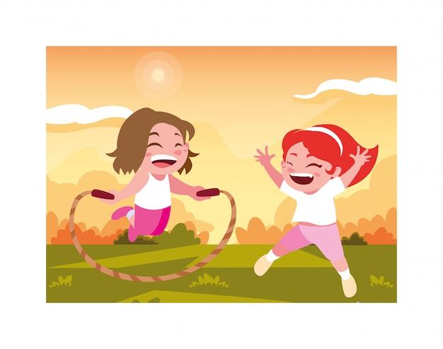Mädchen, die mit springseil lächeln und spielen Premium Vektoren