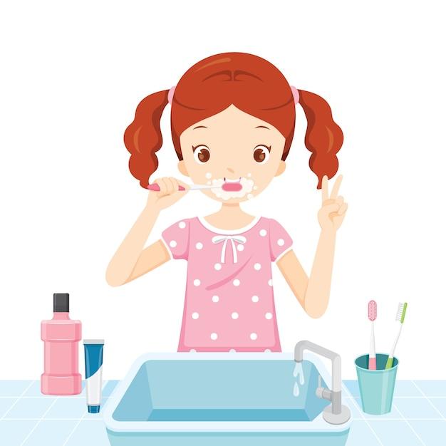 Mädchen im pyjama, das ihre zähne im badezimmer putzt Premium Vektoren
