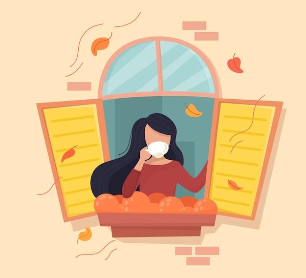 Mädchen mit einer tasse kaffee im herbstfenster. im cartoon flat style. Premium Vektoren