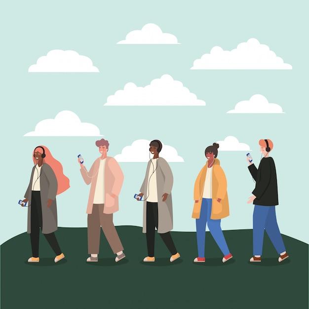 Mädchen und jungen mit smartphones und wolken Premium Vektoren
