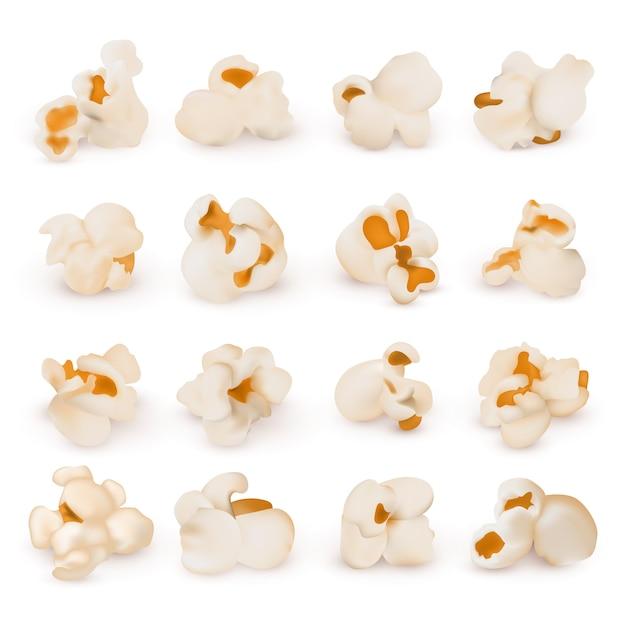 Makro realistisches popcorn lokalisierter vektorsatz. popcornsnackessen, realistische nahrungsillustration Premium Vektoren