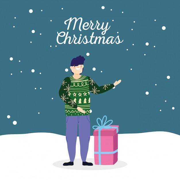 Mann der frohen weihnachten mit hässlicher strickjackengeschenk-schneefeier Premium Vektoren