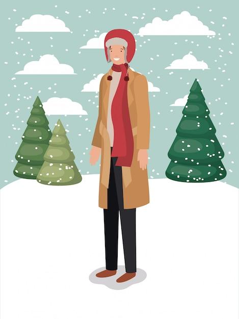 Mann in der schneelandschaft mit winterkleidung Premium Vektoren