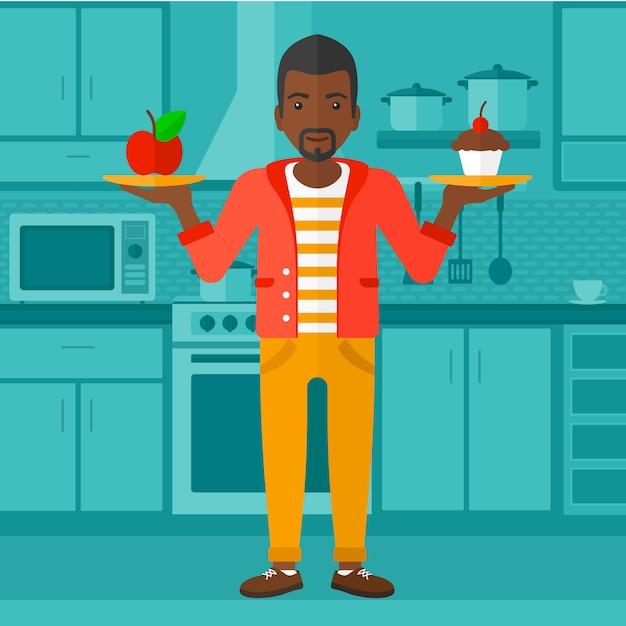 Mann mit apfel und kuchen. Premium Vektoren