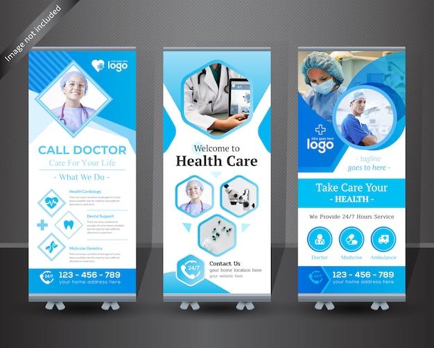 Medizinische rollen sie oben fahnendesign für krankenhaus Premium Vektoren