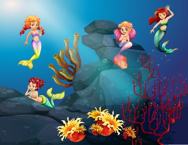 Meerjungfrauen, die unter dem ozean schwimmen Kostenlosen Vektoren
