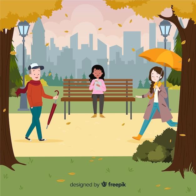 Menschen im park im herbst Kostenlosen Vektoren