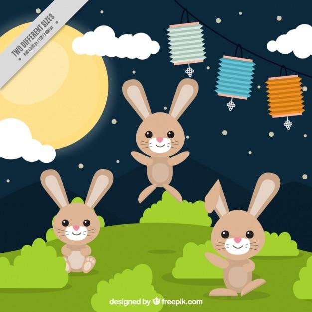 Mid-autumn festival hintergrund von kaninchen in einer wiese Kostenlosen Vektoren
